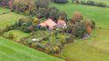 Een foto van de boerderij van Ruinerwold