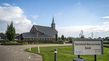 Een foto van de Hersteld Hervormde Kerk in Putten