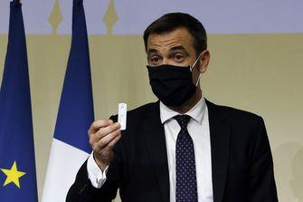 Een foto van minister Veran die moet besluiten over Parijs