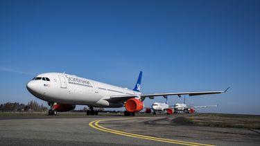 Het vliegtuig van de Scandinavische luchtvaartmaatschappij SAS landde een minuut te laat in Oslo om te voorkomen dat de 158 passagiers aan boord in quarantaine zouden moeten.
