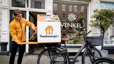 Moederbedrijf Thuisbezorgd.nl ziet helft meer bestellingen