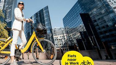 Een foto van de Fiets naar je Werk Dag, een vrouw op de fiets