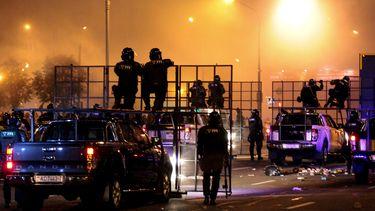 Op deze foto zie je de rellen in Minsk
