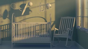 Op deze foto zie je een donkere baby kamer