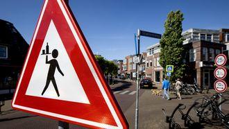 Foto van het waarschuwingsbord voor overstekende obers.