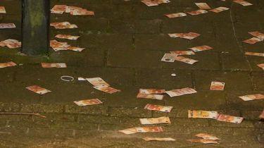 Straat bezaaid met eurobiljetten na brand