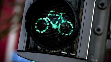 Groen licht via telefoon van fietser en automobilist