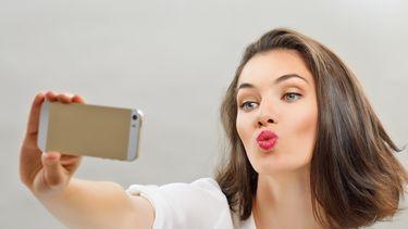 Selfitis: een obsessie met het nemen van selfies.