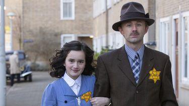 Anne Frank en haar vader.