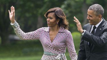 Op deze foto zijn Michelle en Barack Obama te zien.