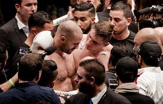 Rico Verhoeven benadert Badr Hari na afloop van het gevecht. Hari raakte gewond aan zijn arm. / ANP