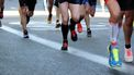 Op deze foto zijn mensen te zien die aan het hardlopen zijn.