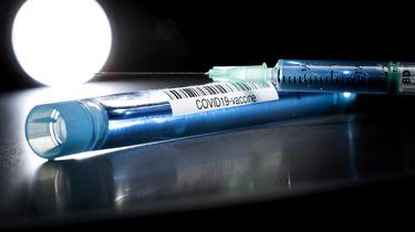 Foto ter illustratie van het coronavaccin