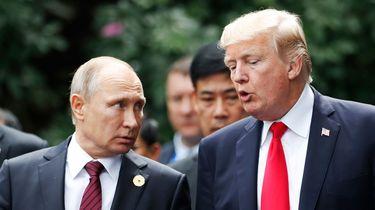 Donald Trump en Vladimir Poetin praten over Syrië. / AFP