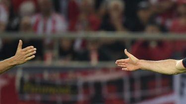 Thomas Müller (l) en Robert Lewandowski van Bayern