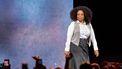 Een foto van Oprah Winfrey die een publiek toespreekt