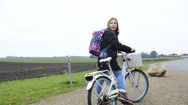 Foto van een kind op fiets