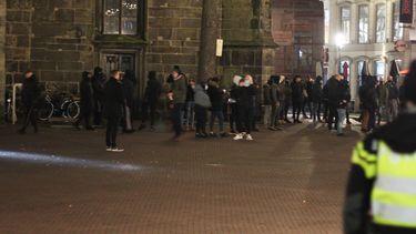 Politie in Enschede bij rellen